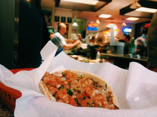 La Taqueria: carnitas taco (& in the background - the amazing old man behind counter)