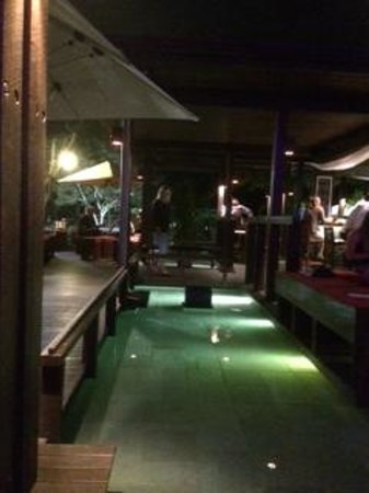 Salt House: Water surrounds the bar - looks beautiful at night