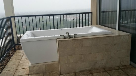 hot needs tubs glass in houston call your masonry tub surrounding inc areas blocks photo block and at systems for
