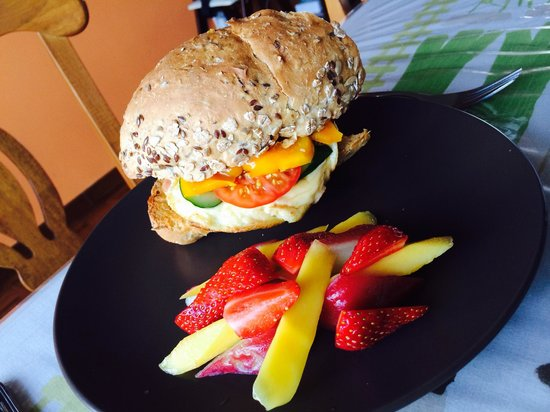 Do Chic In: Sandwich with bacon,eggs & cheese served with fresh local fruits