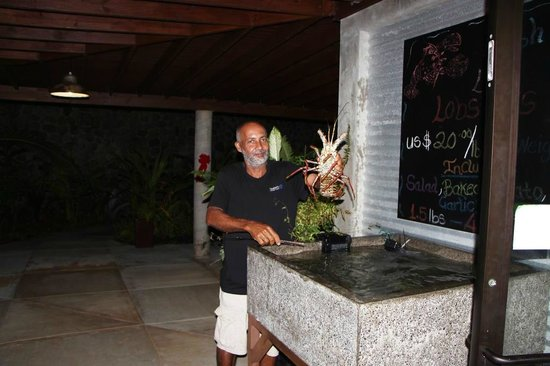 Pagua Bay Bar and Grill : Mikey holding up the prized fresh lobster choice for a guest.