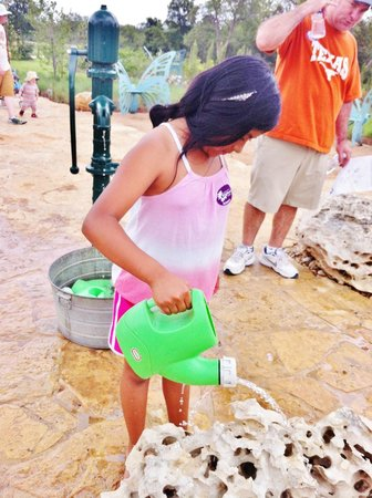 Lady Bird Johnson Wildflower Center : Watering rocks in the Family Garden