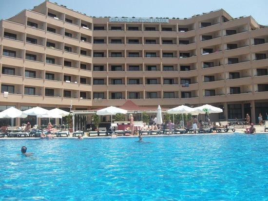 Grand Prestige Hotel & Spa: View of the main hotel building from behind the pool