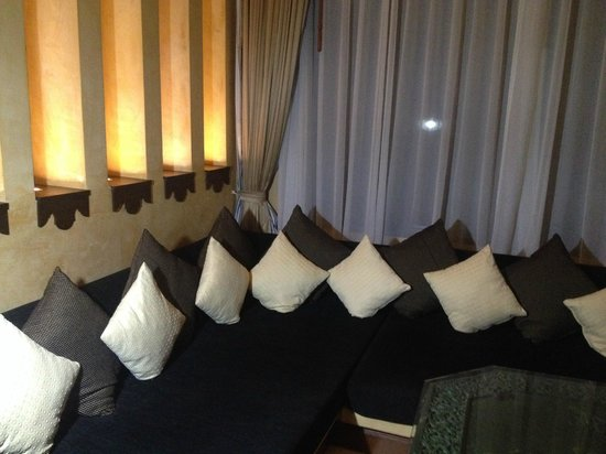 The Baray Villa : large couch in living room area of villa