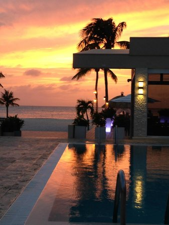Elements Restaurant - Adults Only: Sunset over the pool and Elements