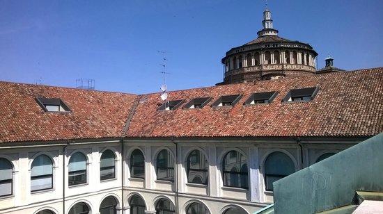 Palazzo Delle Stelline : patio and Santa Maria church