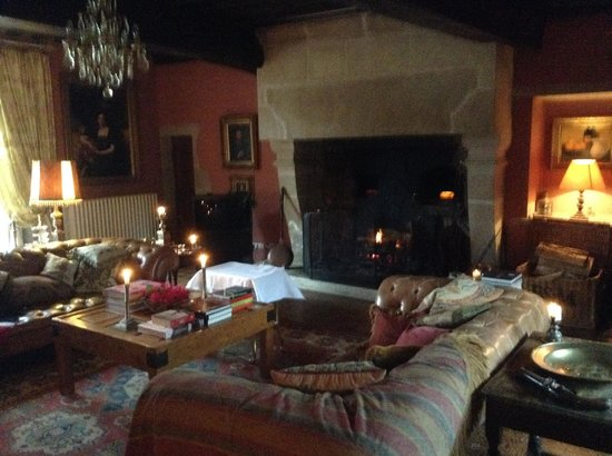 Chateau de Roussac : Sitting room by open fire