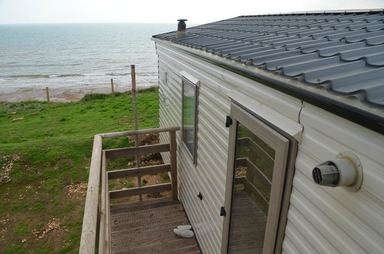 Grange Farm: View of cliff side static caravan with beach