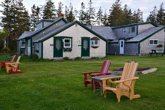 Inn at Whale Cove Cottages: Part of the dining room, office building