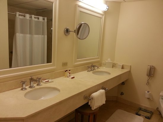 Boca Raton Resort, A Waldorf Astoria Resort : Spacious bathroom with double sinks, makeup mirror and stool