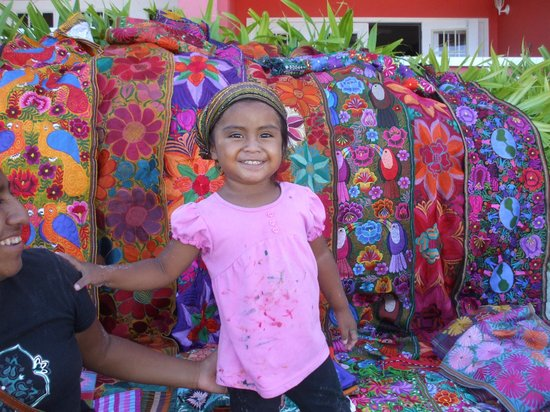 SunBreeze Suites: Mayan Child with handmade-crafts sold on beach
