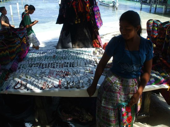 SunBreeze Suites: Mayan woman selling arts and craft