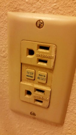 Super 8 Poplar Bluff Missouri: Nasty dirty socket cover in our room.  He switch plates were as bad.