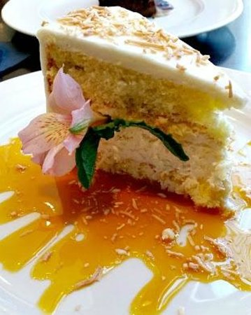 """Wild Sage American Bistro : """"Soon to be Famous"""" coconut cake with passion fruit sauce."""