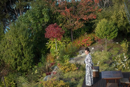 Split Apple Retreat: wife on the deck in front of the Lotus Suite