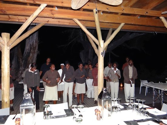 """andBeyond Xudum Okavango Delta Lodge: Staff signing and dancing in """"Sing for Life"""" choir in the dining area"""