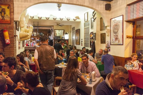 Photo of Pizza Place La Gavina at Calle Ros De Olano, 17, Barcelona 08012, Spain