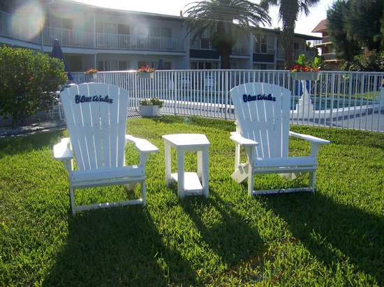 Blue Water Beach Club: chairs on grounds with pool in the background