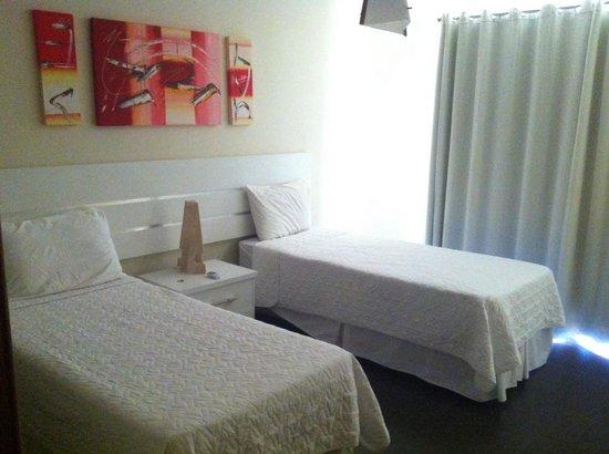 Toko Village: Apartamento 203 jardim - quarto
