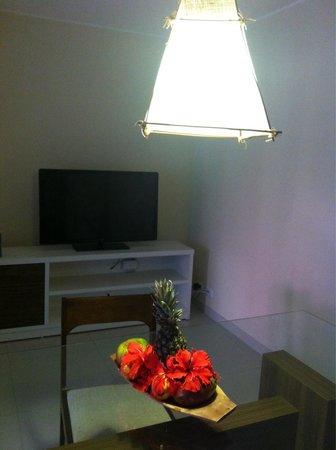 Toko Village: Apartamento 203 jardim - sala