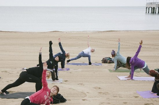 The Coastal Activity Park: Yoga on the beach is an excellent way to soothe the mind and tone the body