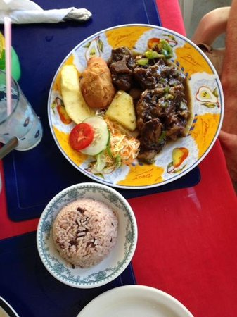 Sips & Bites: Curry Goat (w/rice & peas, yellow yam, festival, roasted breadfruit and side of salad)
