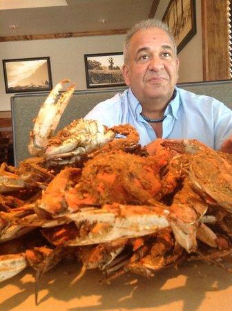 Madonna Seafood Restaurant: My hubby enjoying the crabs