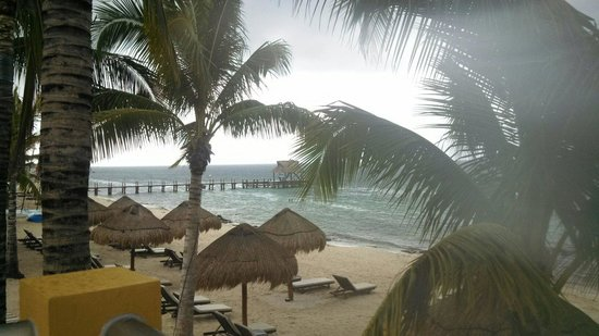 Secrets Aura Cozumel : A storm blew in for a bit and was fun to watch