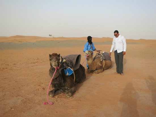 Morocco Key Travel: Ibrahim and Omar readying our camels