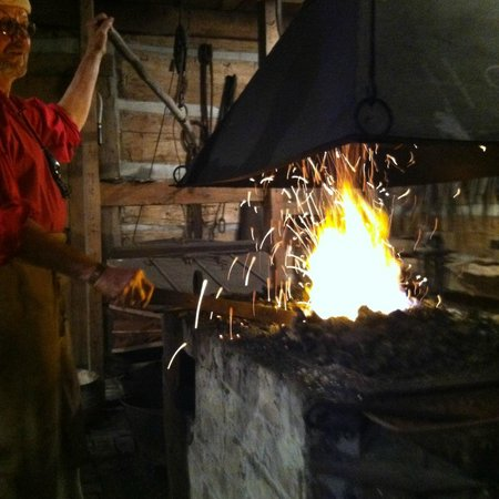 Heritage Farm Museum and Village: The Blacksmith stokes the flame