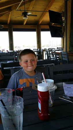 Boshamps Seafood & Oyster House: My son enjoying his ice cream on the deck.