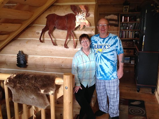 Copper Moose B& B: Cathy and CD in front of a copper moose