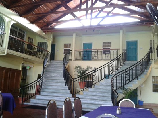Grand Coastal Hotel: staircase leading to outside dining area