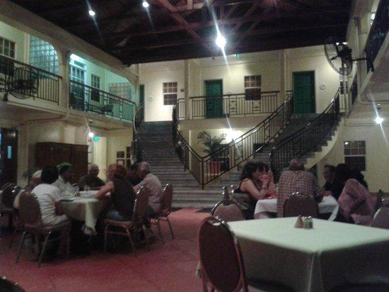 Grand Coastal Hotel: outside dining area at night