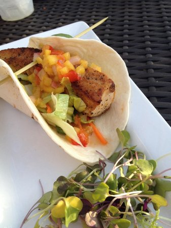 West Bay Beach, a Holiday Inn Resort: Mahi taco is out of this world!  Could make this a meal.