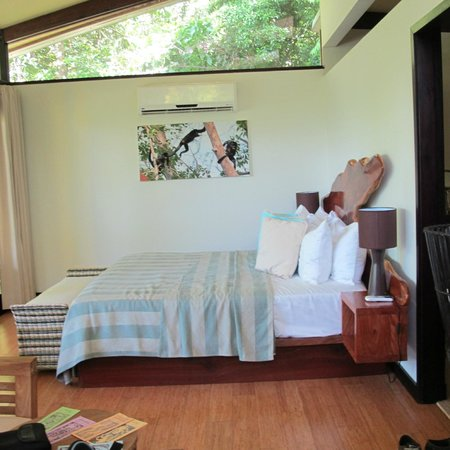 The Resort at Isla Palenque: 'Our' Ocean Estate Top Bunk room. Note transom /monkey channel window above bed
