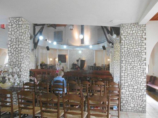 Protestant Church: pews inside church, stone columns