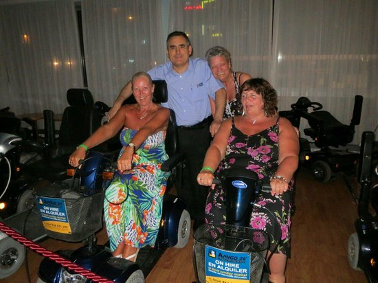 Riudor Hotel Benidorm : Paco bar manager with Jackie, Carol and Lesley posing on scooters.