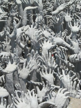Wat Rong Khun : Check out the detail of the single red fingernail. Apparently glows at night