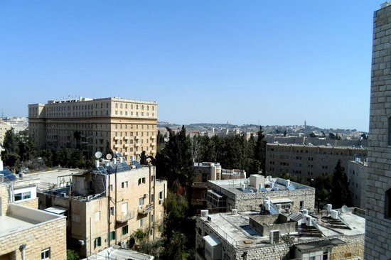 Dan Panorama Jerusalem: View from the Carmel Lounge (King David Hotel/Street on left & Mt. of Olives in background)