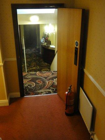 Donn Carragh: DC door held open with fire extinguisher