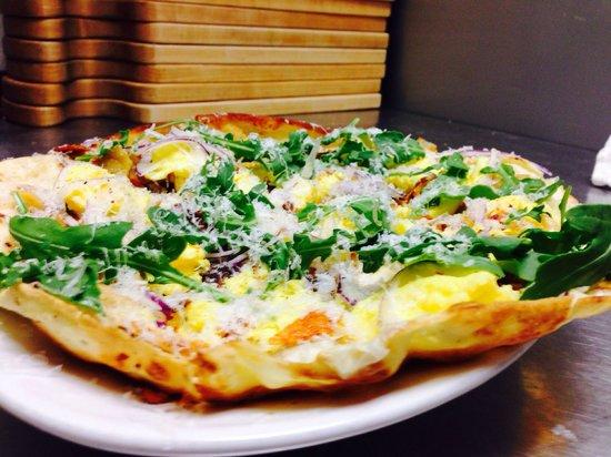 Tutto Bene : Brunch pizza.  Truffled egg / pancetta / fontina fondu / red onion / potato chip