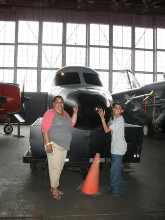 Naval Air Station Wildwood Aviation Museum: My mom and brother standing in front of one of the exhibits. You can actually go in this one!