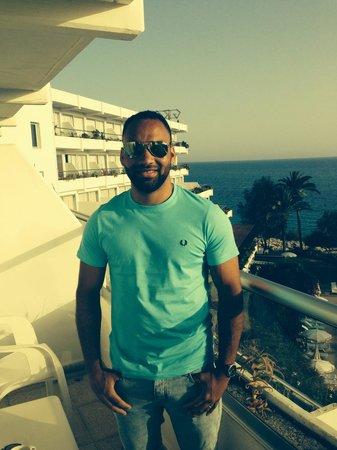 Grecian Sands Hotel: Husband on the balcony