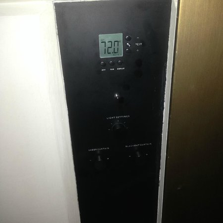 Hotel Cafe Royal: controls for temp, lights, electrically operated curtains
