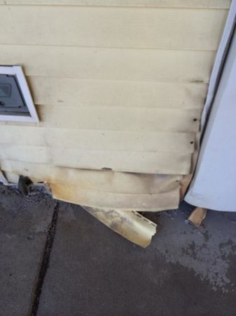 Waukegan, IL: Siding coming off the wall