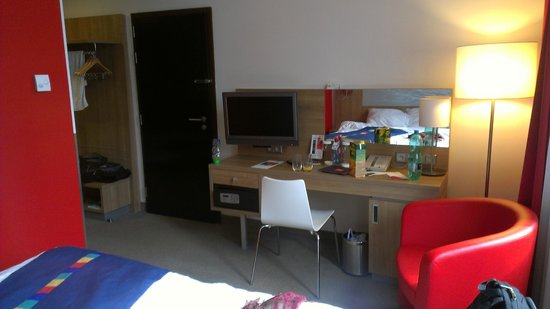 Park Inn Hotel Prague : Flat screen tv's, desk, and safe.