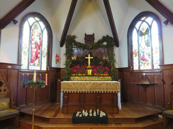 DeLand, FL: The altar, with the Good Shepherd window (Tiffany, 1886) on left.