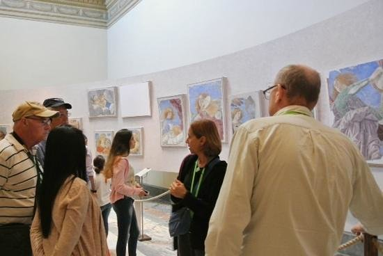 Through Eternity - Day Tour: our guide and small group looking at frescos