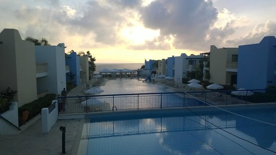 Eleni Holiday Village: View of the pools, down to the med at sundown